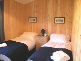 Click to see an enlarged view of the twin bedroom.
